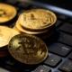 Bitcoins on a black laptop